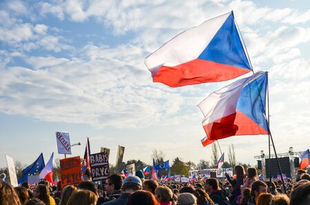 Prague, Czech Republic - Nov 16, 2019: Crowd protests against Prime Minister Babis and Minister of Justice on Letna, Letenska plan. The 30th anniversary of the fall of communism, waving Czech flags. 報道画像