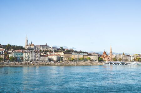 Danube river in Budapest, Hungary. The historic old town in the background with famous Matthias Church or Fishermans Bastion. Cityscape of the Hungarian capital. Tourist destinations. Reklamní fotografie