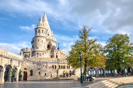 Budapest, Hungary - Nov 6, 2019: Fishermans Bastion in the Hungarian capital city. One of the best-known monuments in town, built in Neo-Romanesque style. People on the adjacent courtyard.