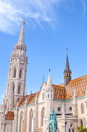 Tower of the Matthias Church in Budapest, Hungary on a vertical photo. Roman Catholic church in the Gothic style. Located in front of Fishermans Bastion in Buda Castle District. Tourist attraction. 写真素材