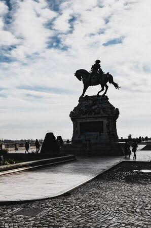 Budapest, Hungary - Nov 6, 2019: Silhouette of the equestrian statue of Savoyai Eugen in the courtyard of the Buda Castle. Against the sun, shadows of the statue and building.