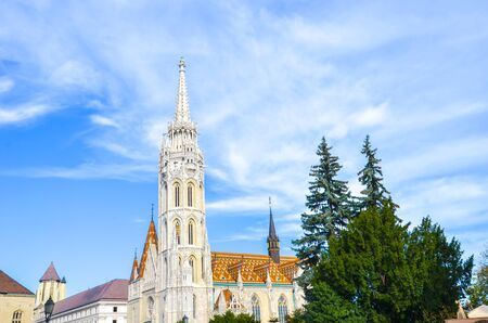Spire of the famous Matthias Church in Budapest, Hungary. Roman Catholic church built in the Gothic style. Located in front of the Fishermans Bastion in Buda Castle District. Hungarian tourist spot.