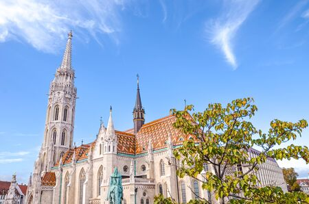 Amazing Matthias Church in Budapest, Hungary. Roman Catholic church in the Gothic style. Located in front of Fishermans Bastion in Buda Castle District. Major Hungarian tourist attraction.