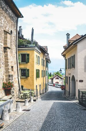 St. Saphorin, Switzerland - July 9, 2019: Historical street in picturesque winemaking village Saint Saphorin in Swiss Lavaux wine region. Traditional houses, cobbled streets. 報道画像