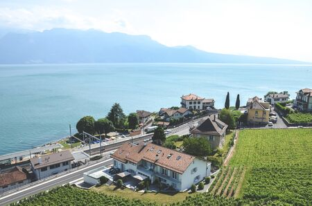Rivaz, Switzerland - July 9, 2019: Amazing winemaking village Rivaz in Swiss Lavaux wine region. Houses located by the beautiful Lake Geneva. Natural landscape. European travel destinations.