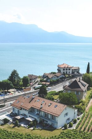 Rivaz, Switzerland - July 9, 2019: Picturesque winemaking village Rivaz in Swiss Lavaux wine region. Houses located by the beautiful Geneva Lake. Natural landscapes. European travel destinations.