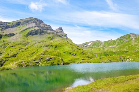 Beautiful Bachalpsee lake in the Swiss Alps in the summer season. Alpine lake and landscape. Popular hiking target on the path from Grindelwald. Tourist attraction in Switzerland. 写真素材