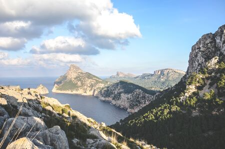 Amazing view from Mirador Es Colomer in Cap de Formentor, Mallorca, Spain. Cliff formations in the Mediterranean. Rocks by the sea. Spanish tourist attraction and popular viewpoint.
