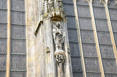 Detail of the outside facade of St. Johns Cathedral in Hertogenbosch, North Brabant, Netherlands. Dutch Gothic architecture, largest catholic church in the Netherlands. Dominant of the city center. Stock Photo