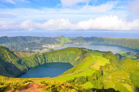 Viewpoint Miradouro da Boca do Inferno in Sao Miguel Island, Azores, Portugal. Amazing crater lakes surrounded by green fields and forests. Beautiful Portuguese landscape. Horizontal photo.