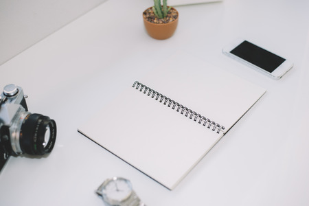 Workspace for designer or hipster style. Flat lay of workplace on white background.