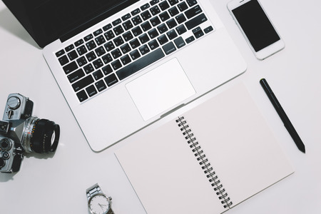 Workspace with laptop, notebook,pen tablets and mobile on white background,Work space for designer or hipster style.