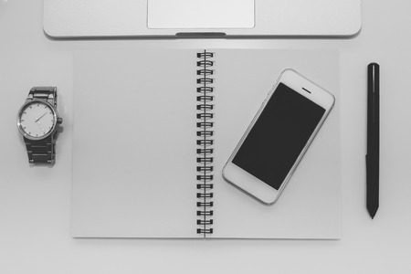 Workspace with laptop, notebook and mobile on white background,Work space for designer or hipster style,black and white