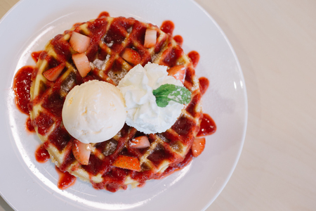 Belgian waffles with ice cream and strawberries Reklamní fotografie