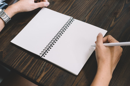 Hand write pencilin a notebook on  wooden background