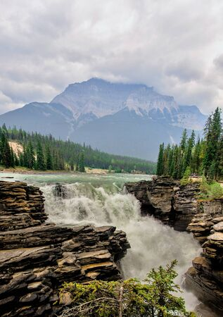Magnificent and massive Athabasca Falls in Jasper National Park, Rocky Mountains, Alberta, Canada. These waterfalls were the first in Canada I saw, and at first glance I was impressed.