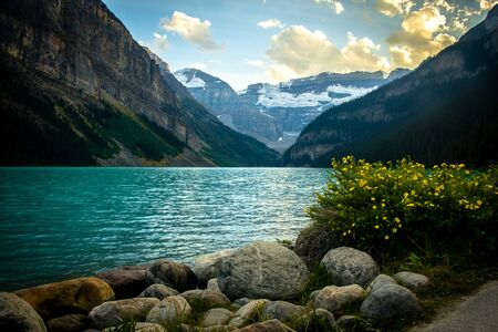 Idyllic atmosphere on the way around Lake Louise in Banff, in the Rocky Mountains, Banff National Park, Alberta, Canada.