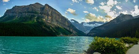 Idyllic atmosphere on the way around Lake Louise in Banff, in the Rocky Mountains, Banff National Park, Alberta, Canada. 写真素材