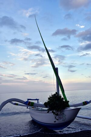 Go fishing  enjoy sunset. Balinese traditional boat called Jukung Dives, Bali. Indonesia, Iceland. 免版税图像 - 130736758