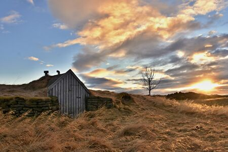 Abandoned and rural turfy house in Iceland, Europe. Dramatic sunset during wintertime in Viking`s land.