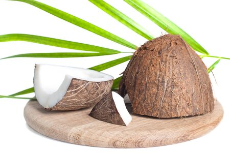 coconut on wooden plate, isolated on white photo