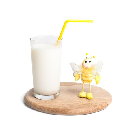 glass of milk on wooden plate, isolated on whitte