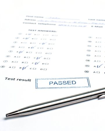 pen and a sheet with tests Stock Photo