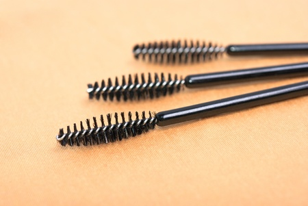 a three black  mascara brushes photo