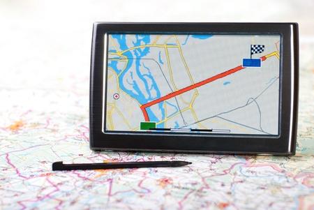 a gps navigator and map Stock Photo