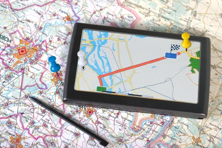 a gps navigator and map Stock Photo