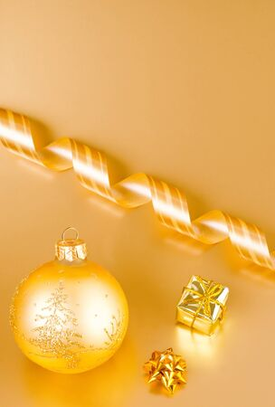 a christmas decoration on gold background Stock Photo - 13032230