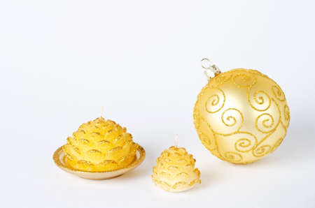 a golden christmas decoration and candle photo