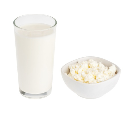 a  milk and cheese isolated on white
