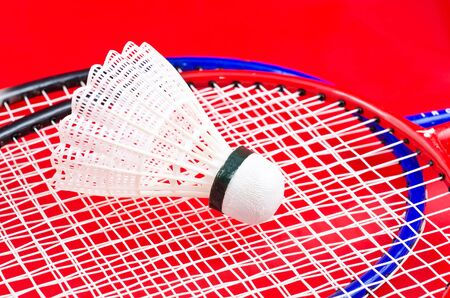 a racket and shuttlecock on red Stock Photo - 13706762