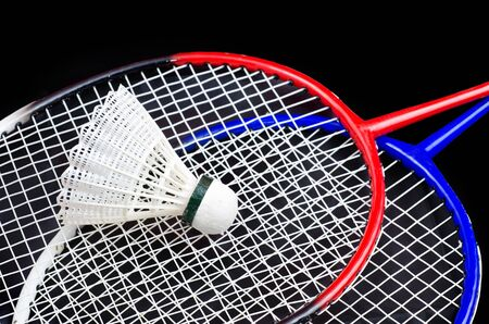 a racket and shuttlecock on black Stock Photo - 13706734