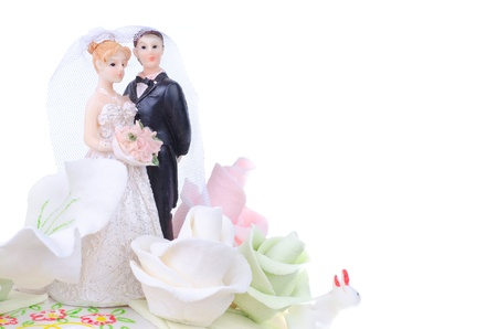 wedding cake decorated with flowers and figures newlyweds photo