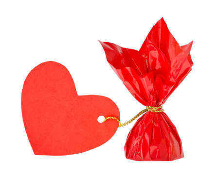 a red candy with heart wrapped message Stock Photo