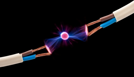 electrical spark between two pair of wires Stock Photo