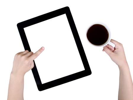 tablet and cup of coffee in hand photo
