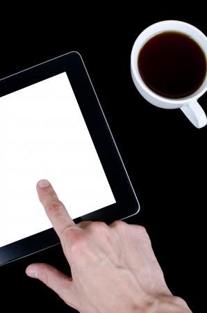 Blank digital black tablet on a desk with epmty whute screen and cup of coffee Stock Photo - 16138609