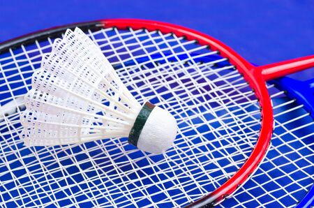 a racket and shuttlecock on blue photo