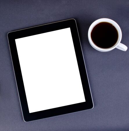 tablet pc and cup of coffe Stock Photo - 16138388