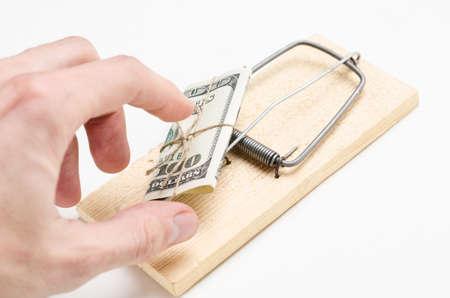 money on mousetrap on white Stock Photo - 17506438