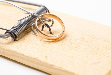 golden wedding ring on mousetrap photo