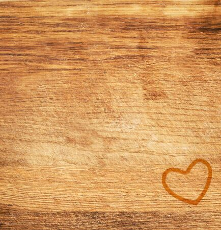 a heart silhouette on wooden desk photo