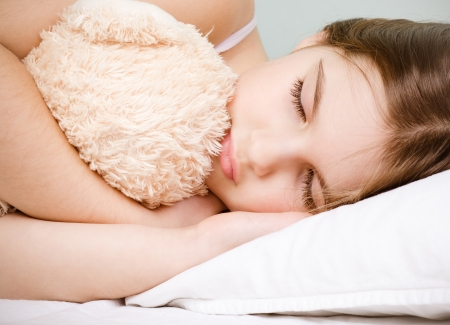 little girl sleep with teddybear photo
