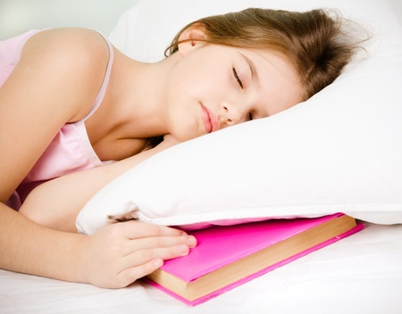 young girl sleep with pink book