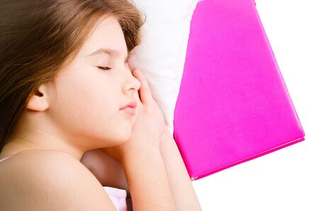 young girl sleep with pink book photo