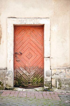 erectum: wall and old vintage wooden door Stock Photo
