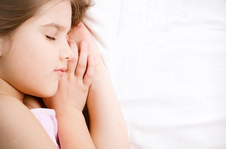 sleeping girl: a sleeping little girl on white